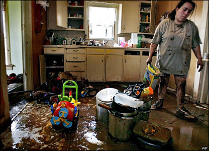 A woman cleans up her flood-damaged kitchen in Kingfisher, Oklahoma