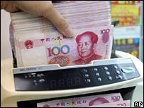 Teller counting yuan notes