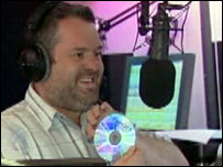 Radio 1 DJ Chris Moyles at microphone