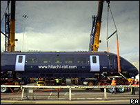 Hitachi train lifted off ferry by crane