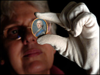 Kay Mitchell, registrar of the curatorial department at the NTS, examining a miniature of Bonnie Prince Charlie