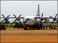 Antonov 12 freighter plane unloading goods at the military apron of El Geneina airport (Photo: Amnesty International)