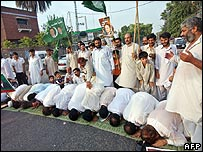 Supporters of Nawaz Sharif offer prayers of thanks outside the court