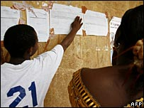 A voter checks the elections results in Sierra Leone