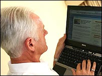 Older man surfing the internet