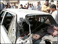 Car damaged in fighting in Baghdad's Shula district