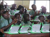 Students with laptops at a school in Nigeria