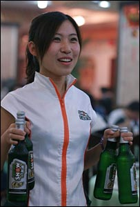 Beijing waitress serving Snow beer