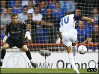 Rangers striker Nacho Novo scores against Inverness