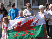 Mourners with Welsh flag