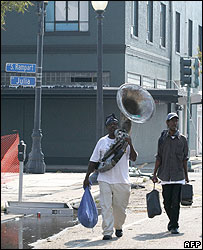 Musician carrying his sousaphone