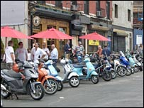 Scooters outside the Brass Monkey bar in New York