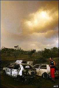 Burned out cars in Artemida, Greece