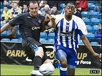 Rangers striker Kris Boyd is followed closely by Simon Ford
