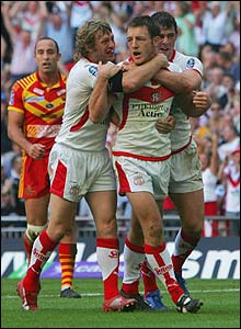 James Roby is congratulated by his Saints team-matesv after scoring the first try