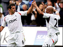 Bolton goalscorer Gary Speed celebrates with El-Hadji Diouf