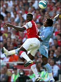 Arsenal defender Kolo Toure challenges Man City's Emile Mpenza