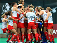 England players celebrate qualifying for Beijing