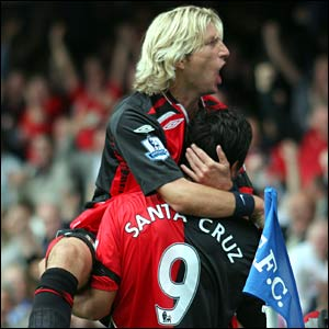 Roque Santa Cruz celebrates scoring the opener with Robbie Savage