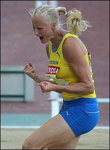 Heptathlon leader Carolina Kluft celebrates