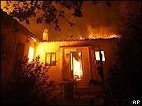 A house burns at Inoi, Greece