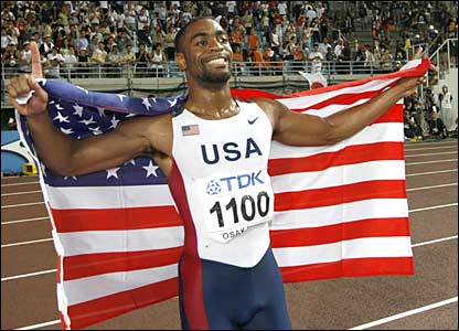 Tyson Gay celebrates gold in the men's 100m final