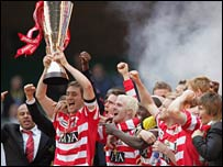 Doncaster celebrate after winning the Johnstone's Paint Trophy in March 2007