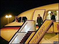 Angela Merkel leaves plane at Beijing airport