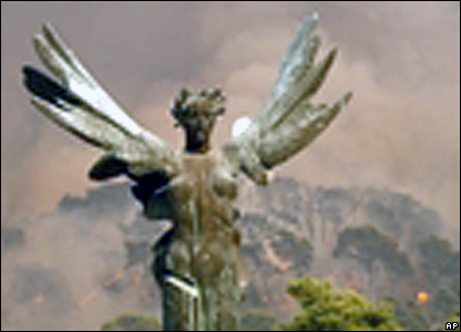 The winged statue victory is surrounded by smoke on the ancient site of Olympia.