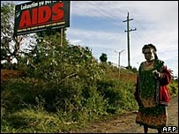 Woman walks by an Aids awareness billboard in PNG - 18/08/07