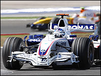 Heikki Kovalainen trails BMW's Nick Heidfeld in the Turkish Grand Prix