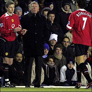 Ole Gunnar Solskjaer (left) replaces Cristiano Ronaldo against Birmingham City