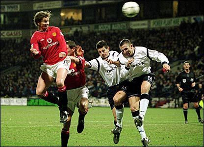 Ole Gunnar Solskjaer scores the second of three goals against Bolton