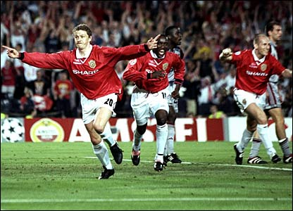 Ole Gunnar Solskjaer (left) celebrates his winning goal with Dwight Yorke (centre)