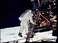 Buzz Aldrin steps down from the Apollo 11 landing craft