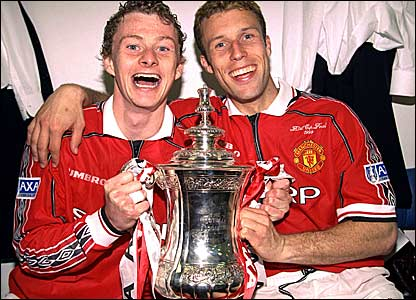 Ole Gunnar Solskjaer (left) celebrates the FA Cup victory with Ronny Johnsen