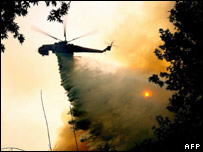 Helicopter over fire. Image: AFP/Getty