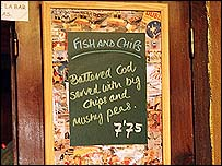 A pub in Spain advertises fish, chips and mushy peas