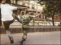 Bangladeshi soldier being kicked by student protester (scanned image from Daily Star)