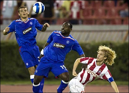 Rangers' Jean-Claude Darcheville (centre) stops Dusan Basta from getting to the ball