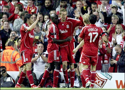 Liverpool's Peter Crouch (centre) celebrates after scoring against Toulouse