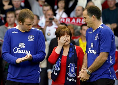 The parents of Everton fan Rhys Jones, Stephen and Melanie and their son Owen