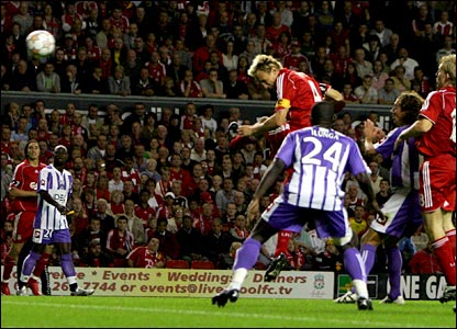 Sami Hyypia leaps above the Toulouse defence to put Liverpool 2-0 up