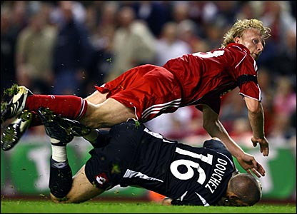 Dirk Kuyt scores his second and Liverpool's fourth goal past Nicolas Douchez
