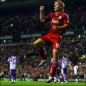 Dirk Kuyt celebrates scoring Liverpool's third goal against Toulouse