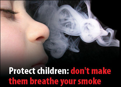 Tobacco packet warning of child inhaling smoke