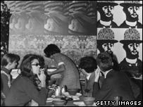 Parisians consider some pop-art in a cafe
