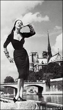 A model poses in front of Notre Dame cathedral