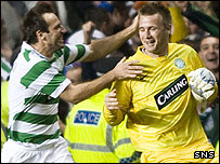 Maciej Zurawski celebrates with Celtic goalkeeper Artur Boruc