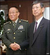 Cao Gangchuan (l) shakes hands with Masahiko Komura (r)